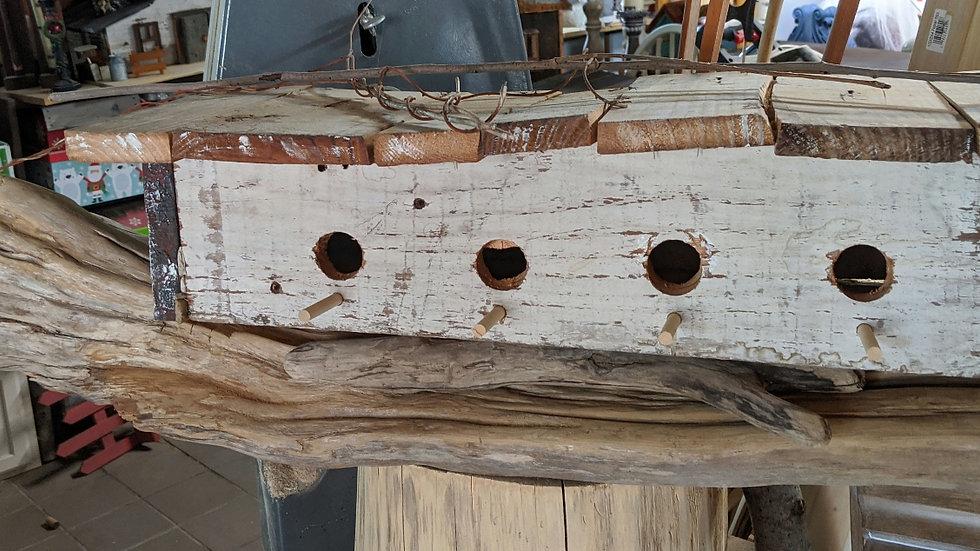 White Birdhouse on Driftwood
