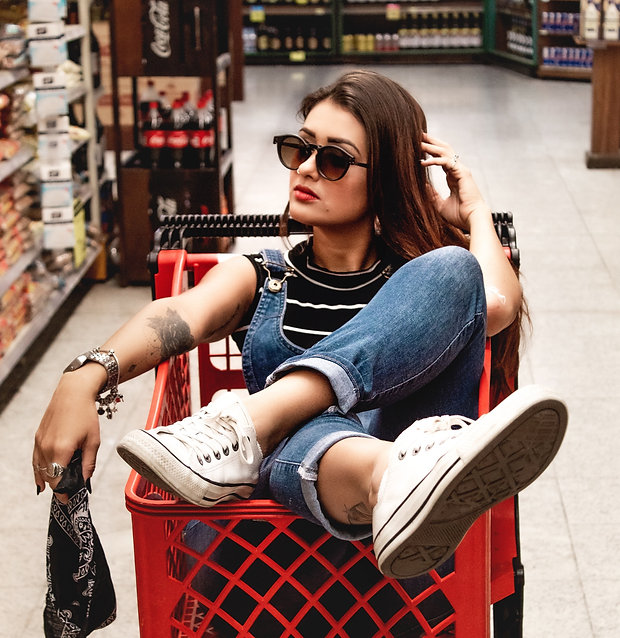 woman-wearing-blue-jeans-riding-red-shop