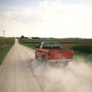 red pick up truck on dirt road.jpg