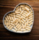 herbal-placenta-pills-heart-on-wood-smal