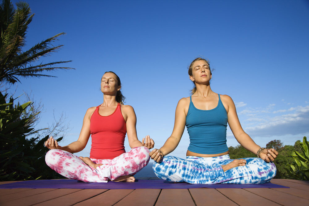 two women meditating. if there's not enough time for a longer meditation, try this ten second meditation
