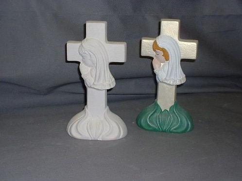 Cross with girl praying