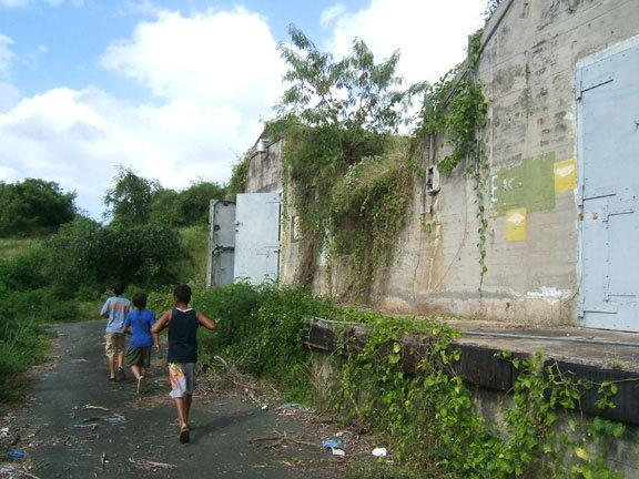 Bieké boys running past magazines