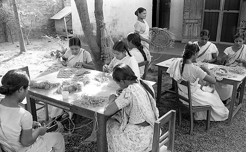 The first jute workshop that MCC initiated. The women are working on different projects.