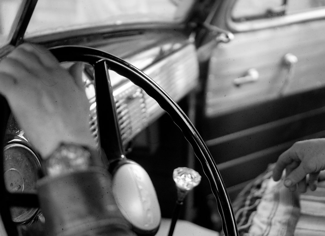 Classic car restoration in Melbourne. A steering wheel on a clasic car.