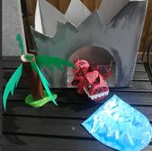 Cardboard cave, tree and dinosaur