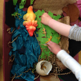 Dinosaur lanscape made by young children