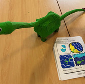 A craft dinosaur and a completed worksheet