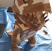 cardboard dinosaur before being painted