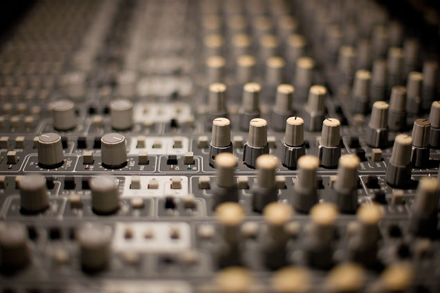 Sound mixed desk slightly blured used as background image.