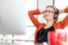 Young woman in office with headphones.jp