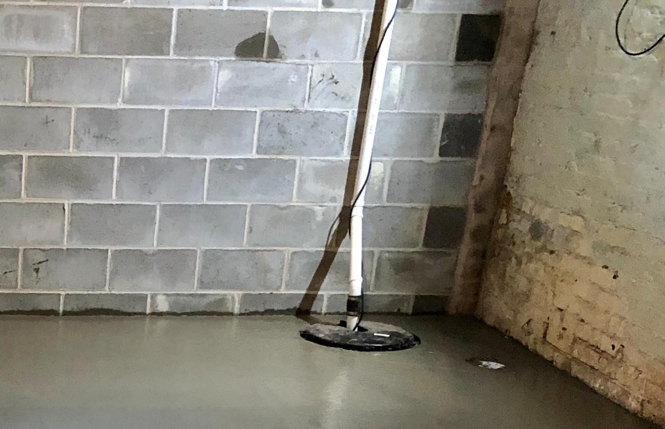 New Concrete Floor, Sump Pump, & New Wall