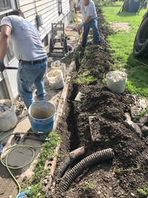 Digging for a tench Drain Install