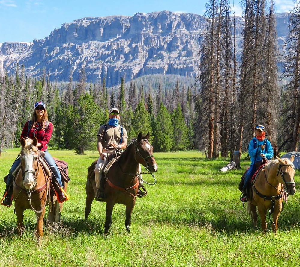World renowned adventurer Jeff B. Evans (center) spends quality time with his family horseback riding at Grand Teton National Park, Wyoming.   Photo © Jeff B. Evans.