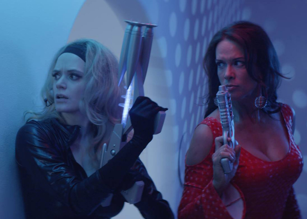 "Co-stars Kipleigh Brown (left) and Chase Masterson (right) from a scene in ""R.U.R.: GENESIS."""
