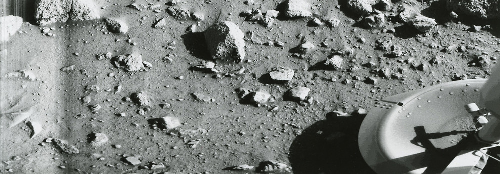 First photograph ever taken on the surface of Mars was obtained by Viking1 just minutes after the spacecraft landed successfully on July 20, 1976.  Photo credit: © The Viking Mars Missions Education & Preservation Project (VMMEPP) and NASA.