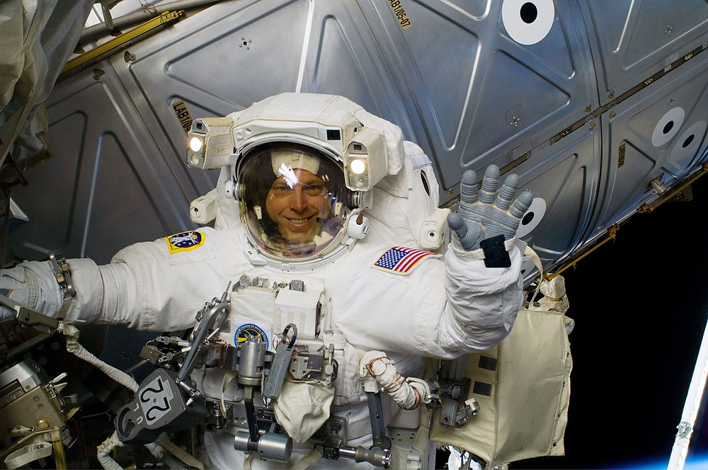 Astronaut Clayton C. Anderson during a spacewalk working on the International Space Station.  Photo credit: NASA.