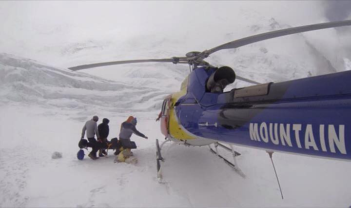 "On Travel Channel's show ""Everest Air,"" Sherpas carry a woman by stretcher to be flown by helicopter to Everest Base Camp and evaluated by high-altitude medic Jeff Evans."