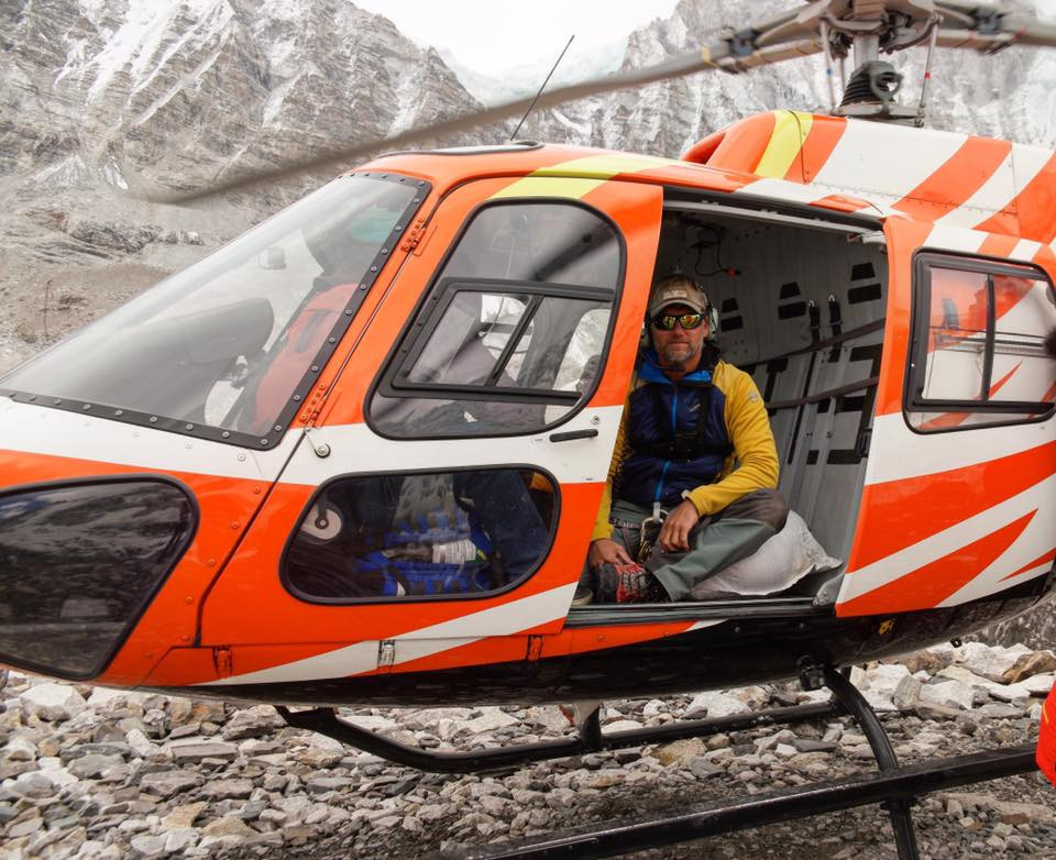 "High-altitude medic Jeff Evans sits in one of the search and rescue helicopters featured on Travel Channel's show, ""Everest Air."""