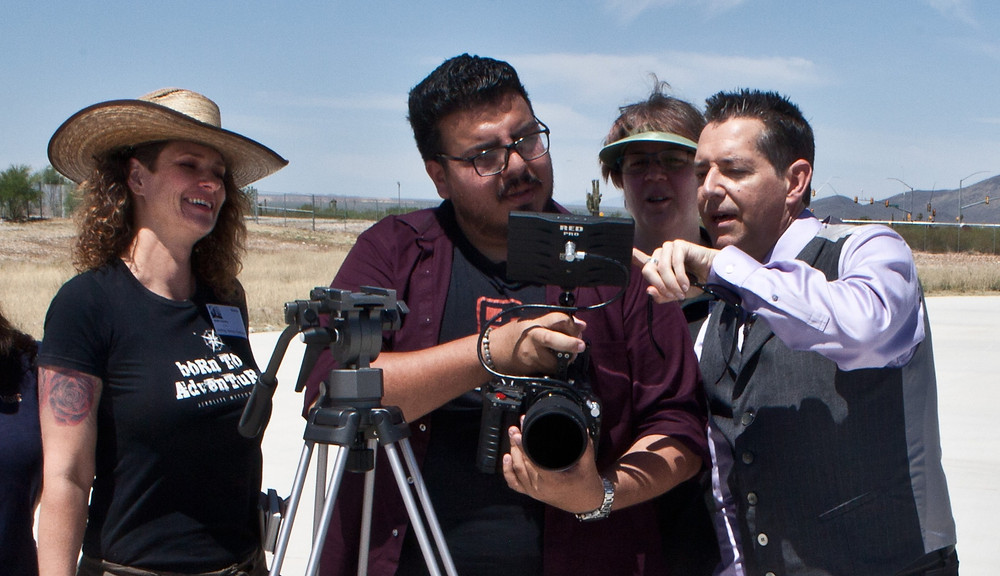 Geoffrey Notkin [pointing] and the Desert Owl Productions checking footage while filming a segment on World View Enterprises spaceflight company at Tucson Spaceport.  Photo by Stu Jenks.