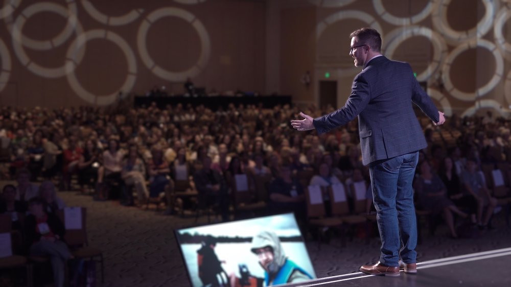 In his uplifting keynote presentations, documentary filmmaker Brett Culp delivers a positive vision for developing a culture that unlocks the heroic spirit in everyone.  Photo © Brett Culp Films.