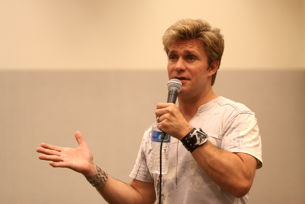 Actor Vic Mignogna speaks to fans at one of his many convention appearances (photo © Vic Mignogna)