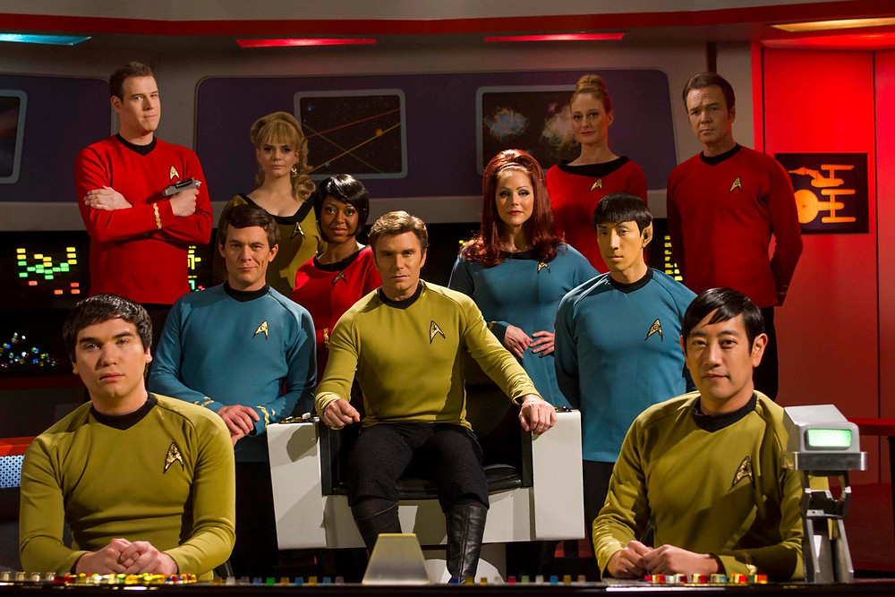 "On the set of the multi-award-winning web series ""Star Trek Continues"" (from left) Wyatt Lenhart as Pavel Chekov; Steven Dengler as Lt. William Drake; Chuck Huber as Doctor Leonard H. McCoy; Kipleigh Brown as Lt. j.g. Bargara Smith; Kim Stinger as Lt. Uhura; Vic Mignogna as Captain James T. Kirk; Michele Specht as Lt. Elise McKennah, PhD; Cat Roberts as Lt. Elizabeth Palmer; Todd Haberkorn as Commander Spock; Grant Imahara as Lt. Hikaru Sulu; Chris Doohan as Lt. Commander Montgomery Scott (photo © Trek Continues, Inc.)"