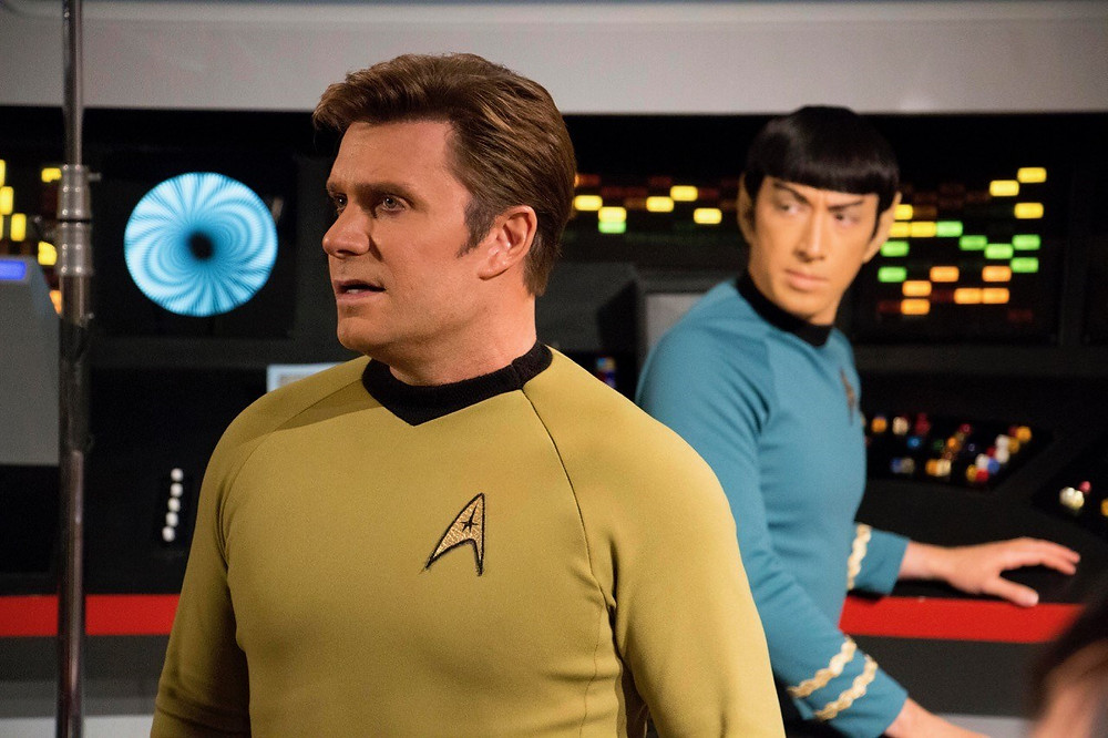 "Actors Vic Mignogna as Captain James T. Kirk and Todd Haberkorn as Mr. Spock (background) filming a scene in ""Star Trek Continues"" (photo © Trek Continues, Inc.)"