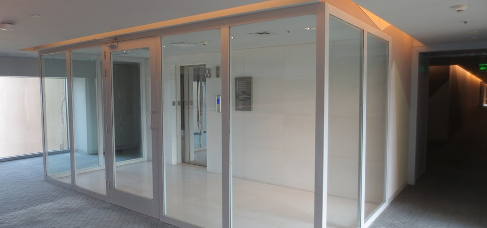 Fire rated glass partition with door