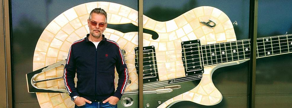 Brian Asha Guitar.jpg