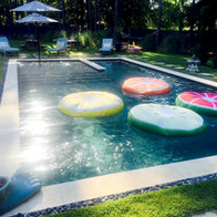Morning swimming pool with floats