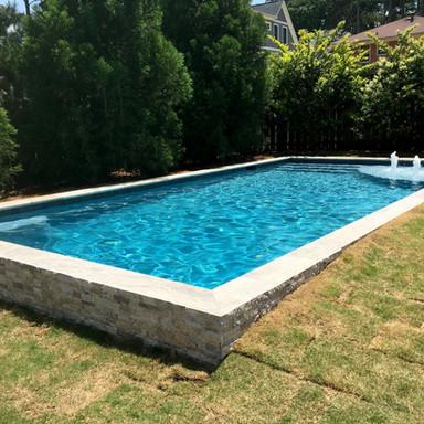 Splitface travertine pool wall