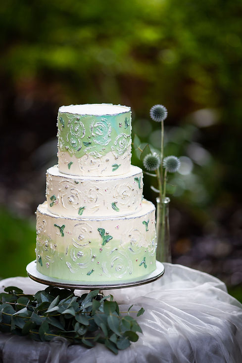 White & sage green buttercream-painted c