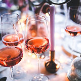 rose wine - wine glasses - on a table