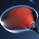 a glass of red wine - chilled red wine on a blue background