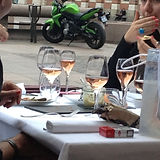 friends having lunch - rose wine glasses on a table - people having lunch and wine