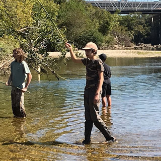 Teens fishing with bushcrafted Tenkara f