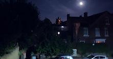 a cityscape under moonlight