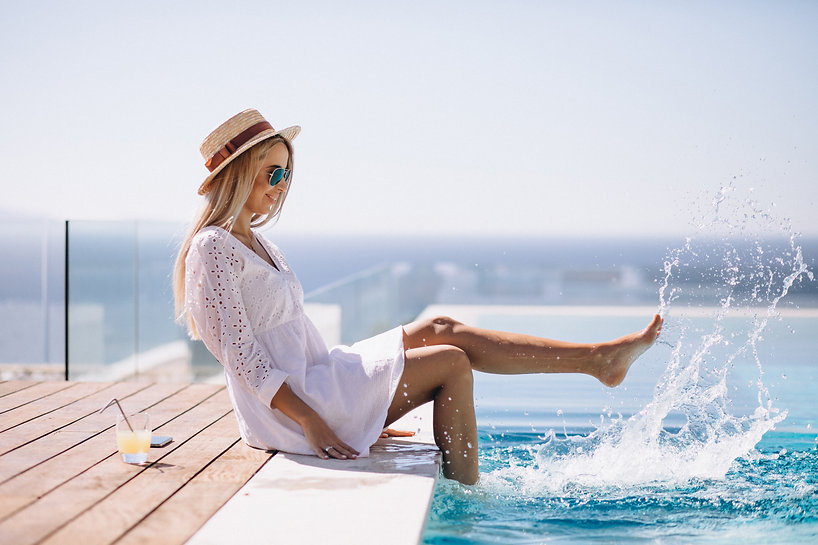 young-woman-on-vacation-by-the-pool.jpg