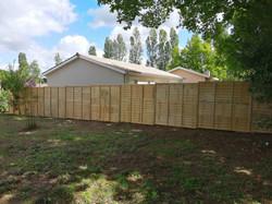 Pose d'une clôture à Tresses