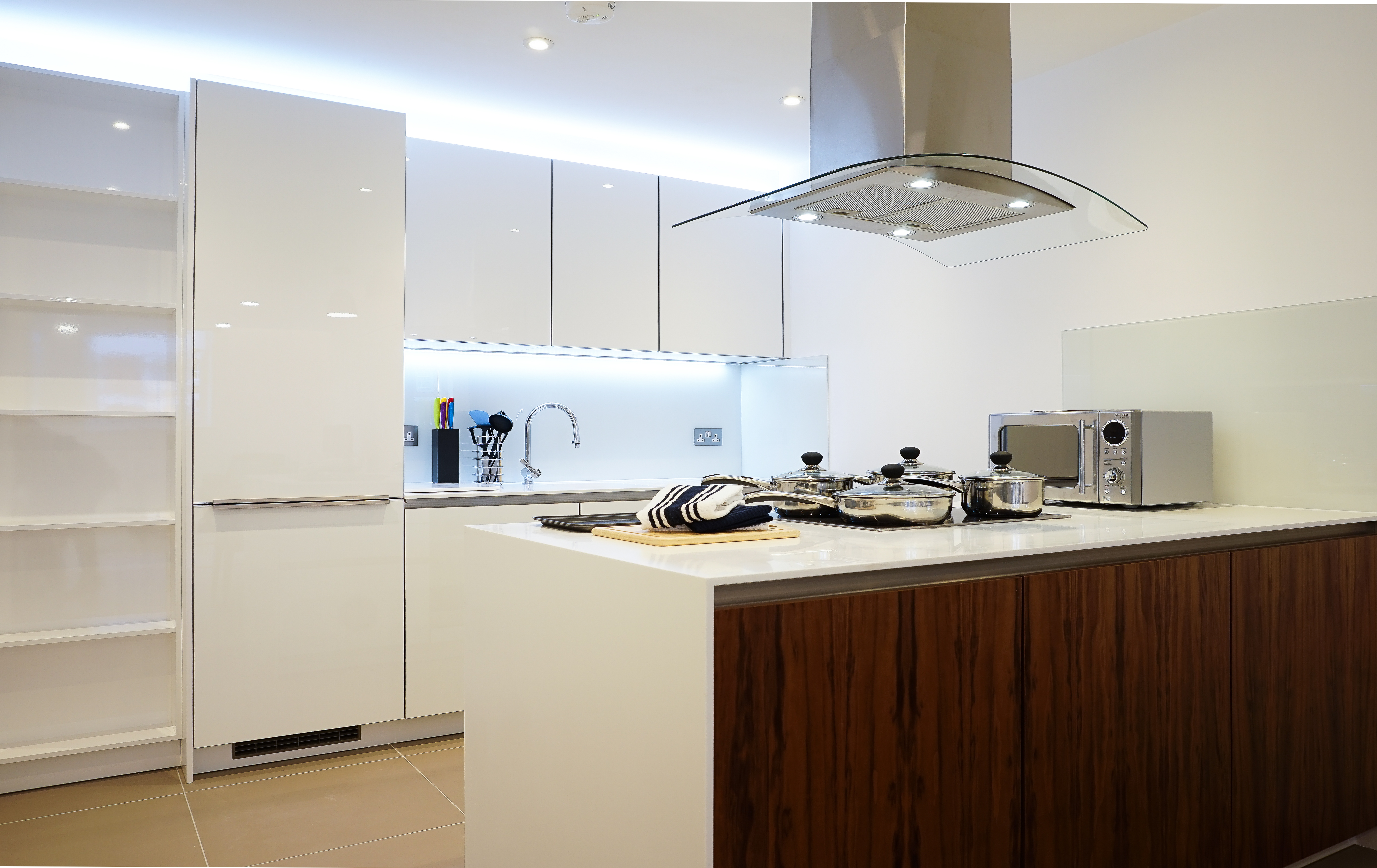A modern kitchen with a clean white aesthetic.