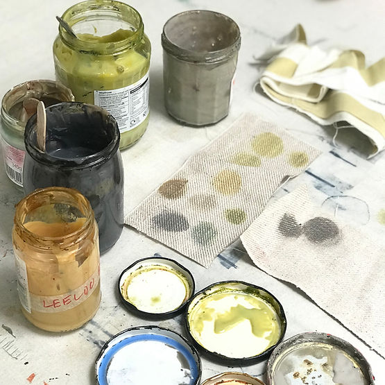 Mixing colours in old glass jars.jpg