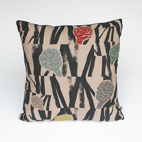 Multi coloured textile design on nude pink linen