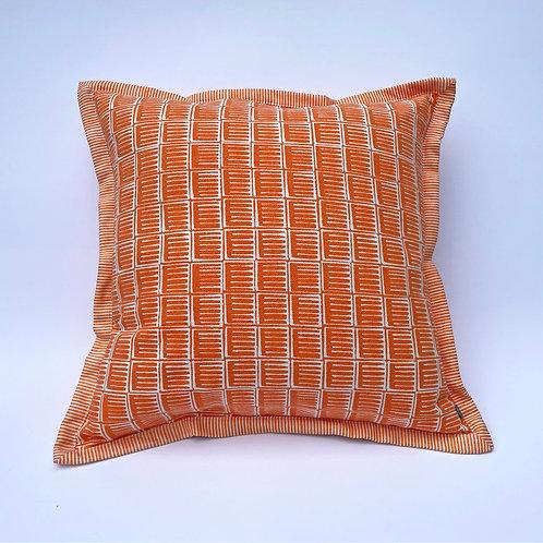 Orange architectural contemporary textile print made into cushion