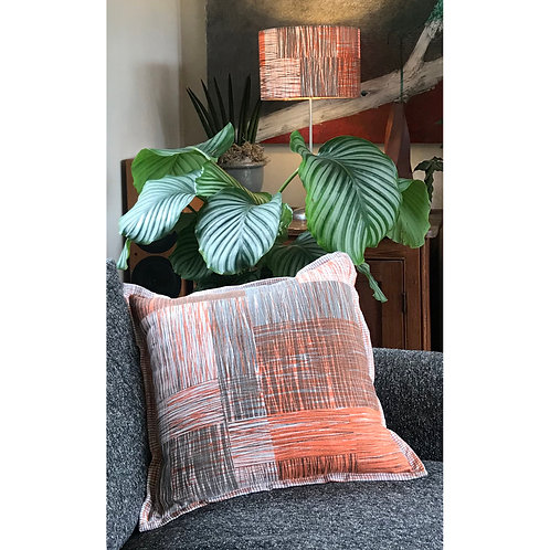 Scratch original hand printed textile made up as large cushion