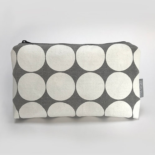 Grey and white spotty cosmetic pouch front