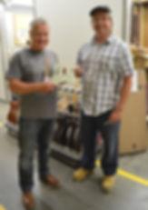 Fender Master Builder Greg Fessler presenting Gary Davies with a signed pickguard at the Fender Custom Shop in Corona California