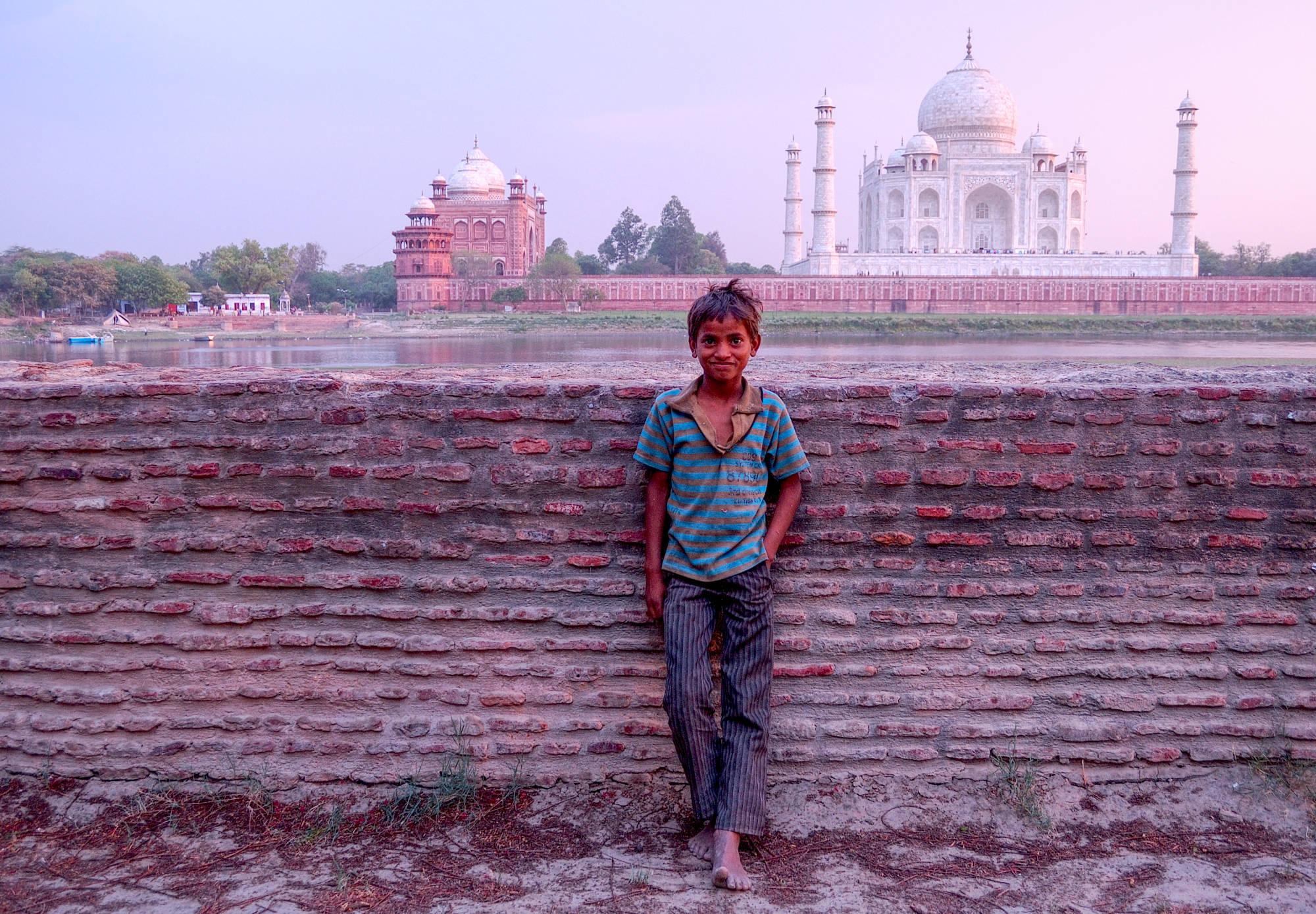 Boy across the river from the Taj Mahal
