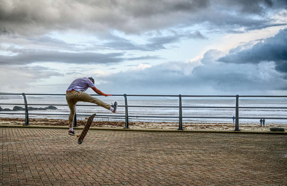 Skateboarder on Looe seafront
