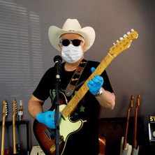 Gary Davies with mask gloves and 40th Anniversary Telecaster guitar self portrait